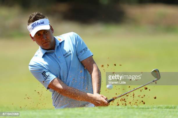 Ian Poulter of England hits a bunker shot on the 2nd hole during the first round of the Nedbank Golf Challenge at Gary Player CC on November 9 2017...