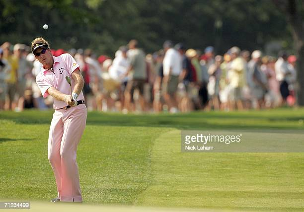 Ian Poulter of England hits a pitch shot to the eighth green hole during the final round of the 2006 US Open Championship at Winged Foot Golf Club on...