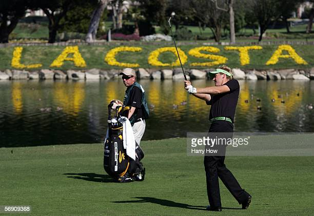 Ian Poulter of England hits a second shot in his match against David Toms on the eighth hole during the first round of the Accenture World Match Play...