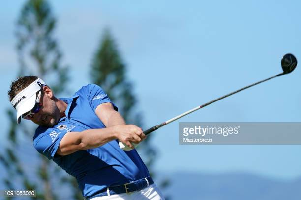 Ian Poulter of England hits a tee shot on the 3rd hole during the final round of the Sentry Tournament of Champions at the Plantation Course at...