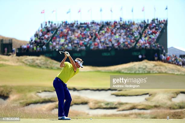 Ian Poulter of England hits a tee shot on the ninth hole during the final round of the 115th US Open Championship at Chambers Bay on June 21 2015 in...