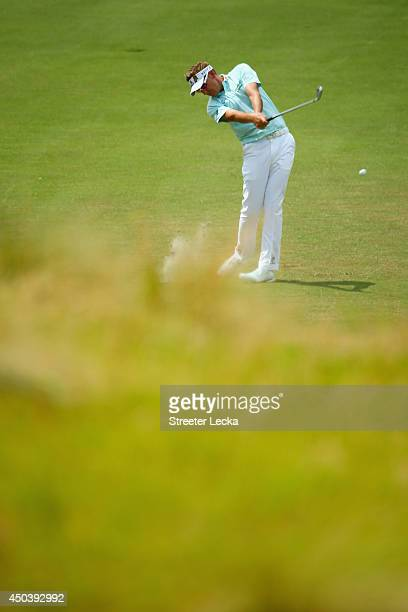 Ian Poulter of England hits an approach shot during a practice round prior to the start of the 114th US Open at Pinehurst Resort Country Club Course...