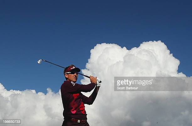 Ian Poulter of England hits an approach shot during day four of the Australian Masters at Kingston Heath Golf Club on November 18, 2012 in Melbourne,...