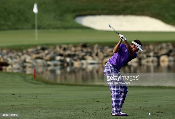Ian Poulter of England hits an approach shot on the 18th hole during the first round of the Arnold Palmer Invitational Presented By MasterCard at the...