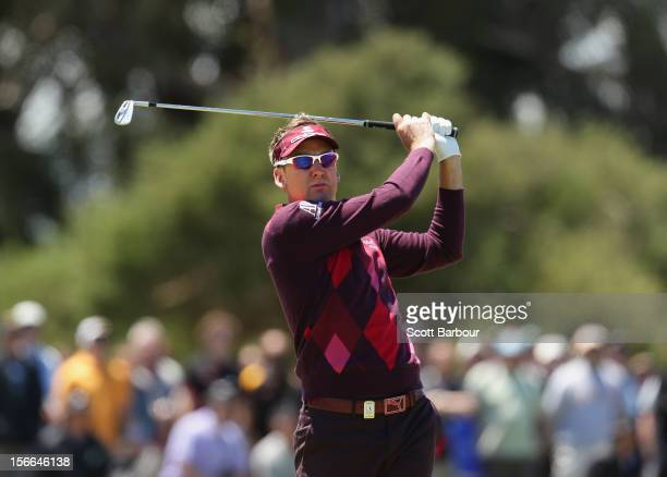 Ian Poulter of England hits an approach shot on the 2nd hole during day four of the Australian Masters at Kingston Heath Golf Club on November 18,...