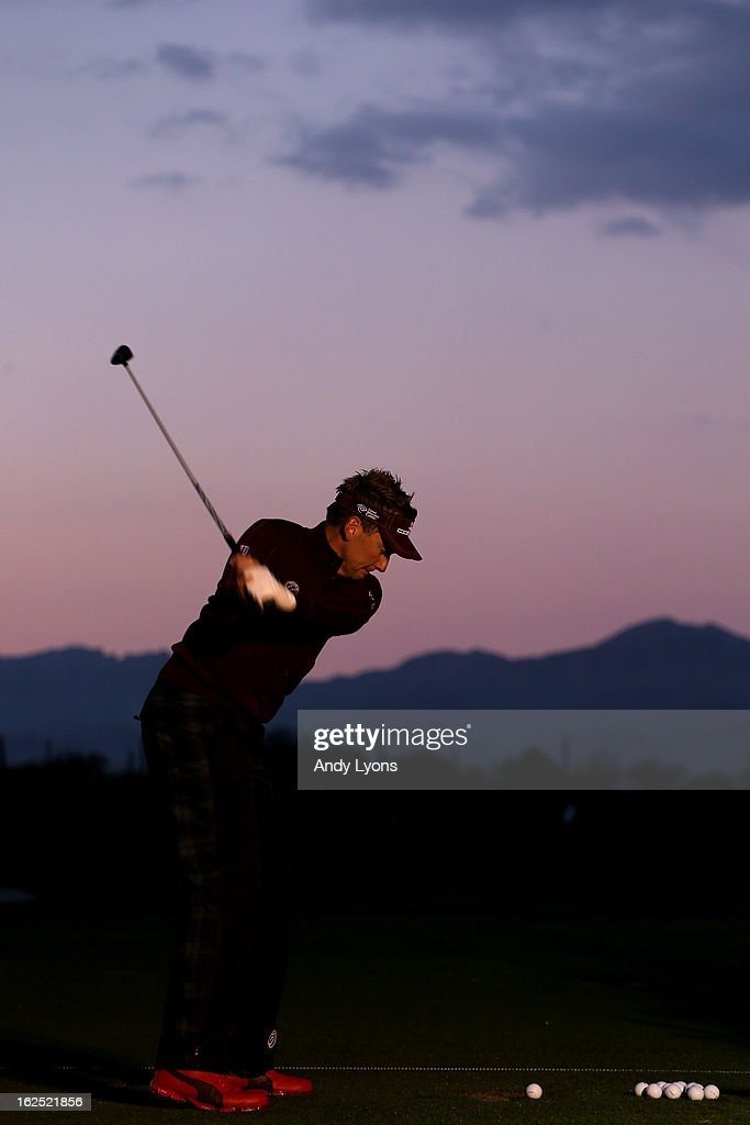 Ian Poulter of England hits balls on the range prior to his match against Hunter Mahan during the semifinal round of the World Golf Championships - Accenture Match Play at the Golf Club at Dove Mountain on February 24, 2013 in Marana, Arizona.