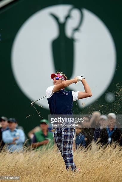 Ian Poulter of England hits his 3rd shot on the 17th hole during the final round of the 142nd Open Championship at Muirfield on July 21 2013 in...