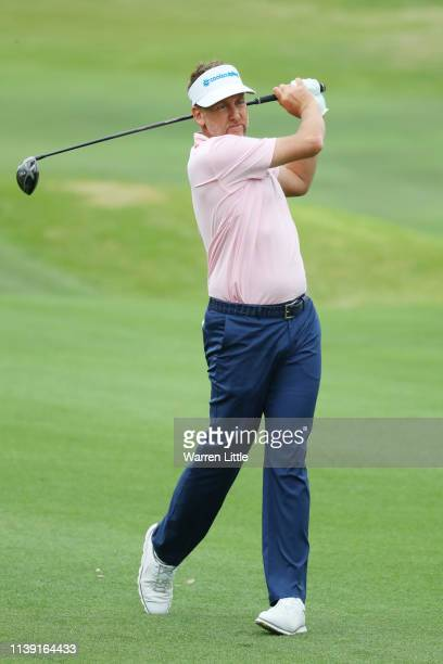 Ian Poulter of England hits his driver off the deck for his second shot on the 16th hole in his match against Tony Finau of the United States during...