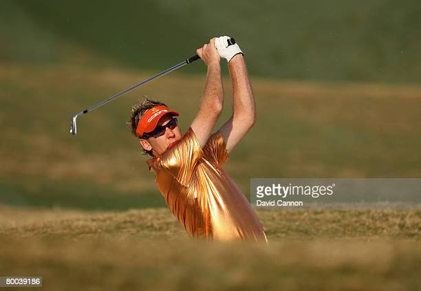 Ian Poulter of England hits his second shot at the 12th hole during the first round of the 2008 Johnnie Walker Classic held at The DLF Golf and...