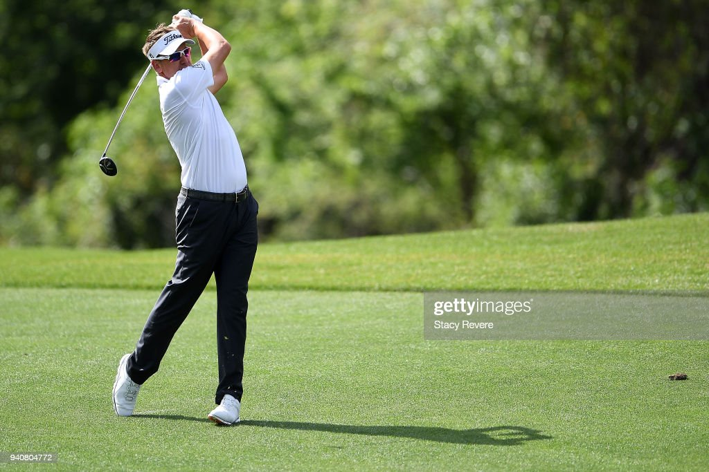 Ian Poulter of England hits his second shot on the 15th hole during the final round of the Houston Open at the Golf Club of Houston on April 1, 2018 in Humble, Texas.