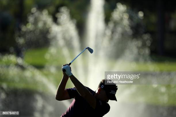 Ian Poulter of England hits his second shot on the 18th hole during the second round of the Turkish Airlines Open at the Regnum Carya Golf Spa Resort...