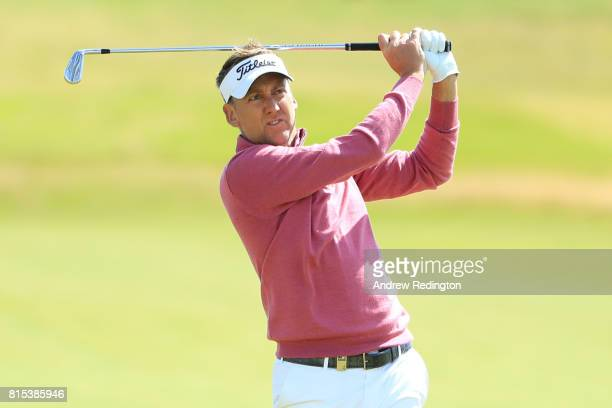 Ian Poulter of England hits his second shot on the 1st hole during the final round of the AAM Scottish Open at Dundonald Links Golf Course on July 16...