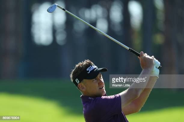 Ian Poulter of England hits his second shot on the 1st hole during the second round of the Turkish Airlines Open at the Regnum Carya Golf Spa Resort...