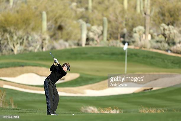 Ian Poulter of England hits his second shot on the par 4 14th hole during the third round of the World Golf Championships Accenture Match Play...