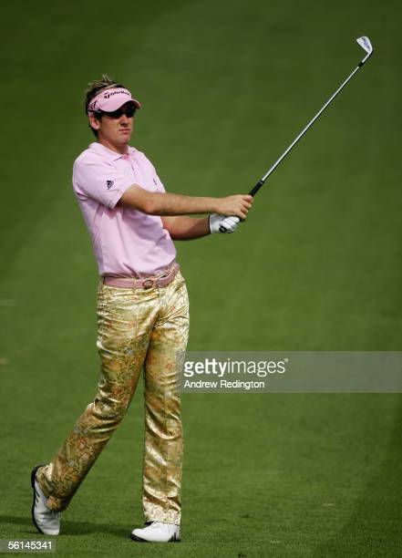 Ian Poulter of England hits his second shot on the second hole during the third round of the HSBC Champions tournament on 12 November 2005 at The...