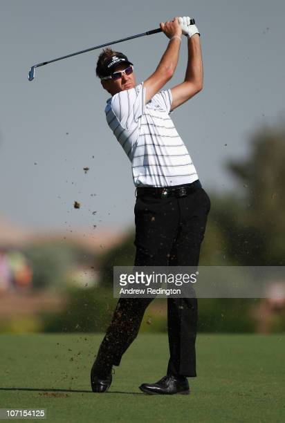 Ian Poulter of England hits his second shot on the tenth hole during the second round of the Dubai World Championship on the Earth Course Jumeirah...