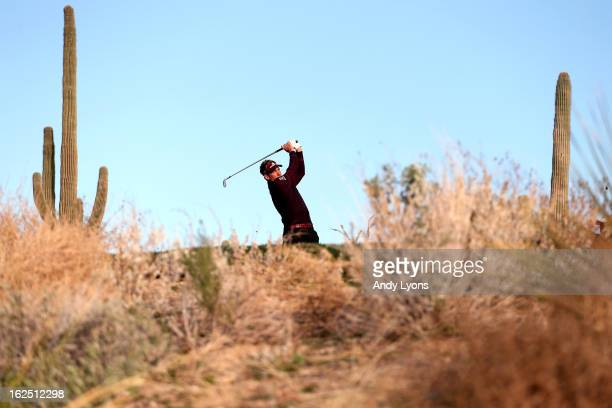 Ian Poulter of England hits his tee shot on the sixth hole during the semifinal round of the World Golf Championships Accenture Match Play at the...