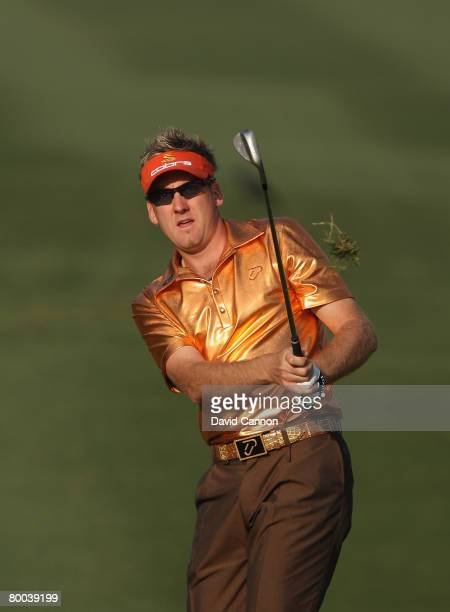 Ian Poulter of England hits his third shot at the 12th hole during the first round of the 2008 Johnnie Walker Classic held at The DLF Golf and...