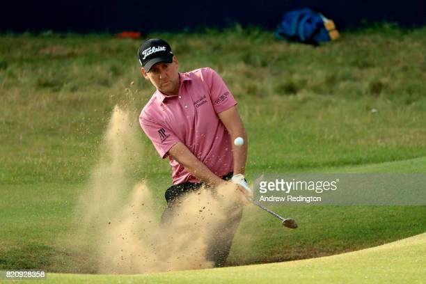 Ian Poulter of England hits his third shot from a bunker on the 18th hole during the third round of the 146th Open Championship at Royal Birkdale on...