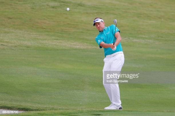 Ian Poulter of England hits his third shot to the 18th green during the first round of the ATT Byron Nelson on May 18 2017 at the TPC Four Seasons...