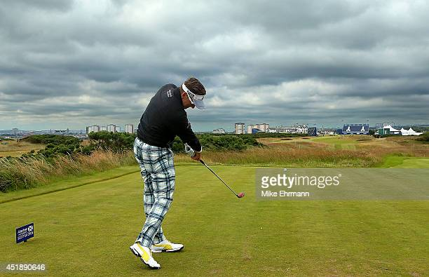 Ian Poulter of England hits hit tee shot on the 18th hole during the ProAm ahead of the 2014 Aberdeen Asset Management Scottish Open at Royal...