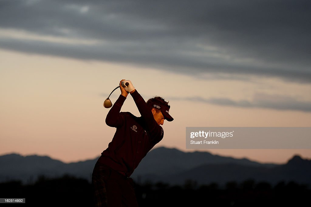 Ian Poulter of England hits practice balls on the range prior to his semifinal round match of the World Golf Championships - Accenture Match Play at the Golf Club at Dove Mountain on February 24, 2013 in Marana, Arizona.