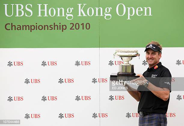 Ian Poulter of England holds the trophy after winning the UBS Hong Kong Open golf tournament at the Hong Kong Golf Club on November 21 2010 Ryder Cup...