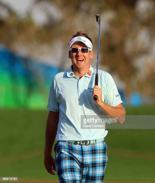 Ian Poulter of England holes a huge birdie putt at the par 5 18th hole during the first round of The Abu Dhabi Golf Championship at Abu Dhabi Golf...