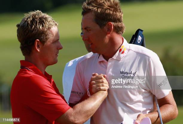 Ian Poulter of England is congratulated by Luke Donald of England after winning the Volvo World Match Play Championship at Finca Cortesin on May 22...