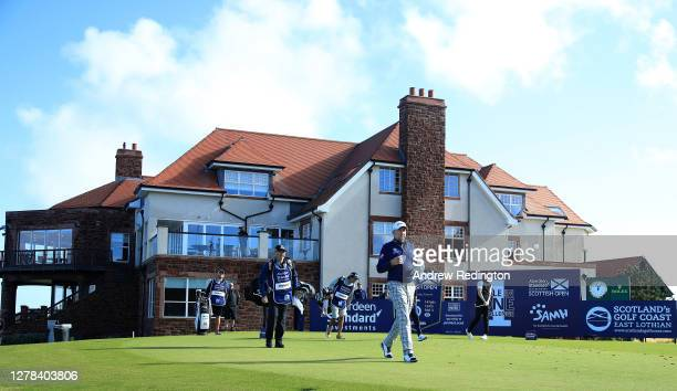 Ian Poulter of England leaves the sixth tee as Marcus Kinhult of Sweden tees off during the final round of the Aberdeen Standard Investments Scottish...