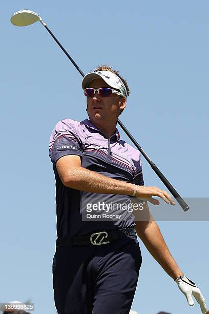 Ian Poulter of England lets go of his club as he tees off during day two of the 2011 Australian Masters at The Victoria Golf Club on December 16,...