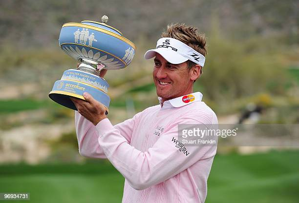 Ian Poulter of England lifts the Walter Hagen Cup throphy on the 16th hole after winning the final round of the Accenture Match Play Championship at...