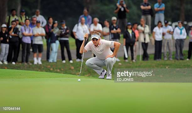 Ian Poulter of England lines up a putt during the third day of the Hong Kong Open golf tournament at the Hong Kong Golf Club on November 20 2010 The...