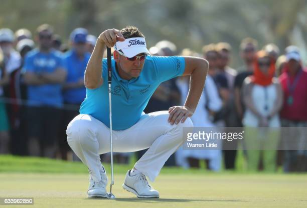 Ian Poulter of England lines up a putt on the 15th green during the final round of the Omega Dubai Desert Classic on the Majlis course at Emirates...