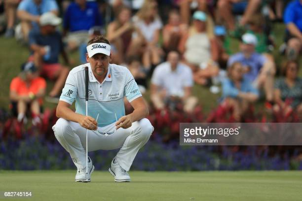 Ian Poulter of England lines up a putt on the 17th green during the third round of THE PLAYERS Championship at the Stadium course at TPC Sawgrass on...