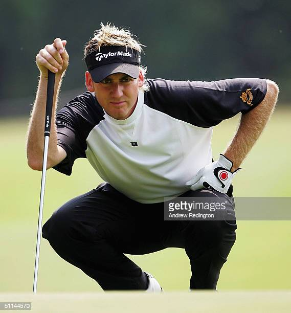 Ian Poulter of England lines up his putt on the 14th hole during the first round of the KLM Open at Hilversum Golf Club on August 5, 2004 in...