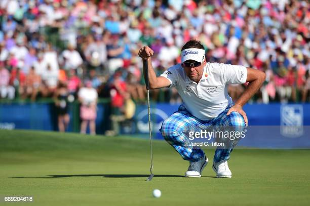 Ian Poulter of England lines up his putt on the 18th green during the final round of the 2017 RBC Heritage at Harbour Town Golf Links on April 16...