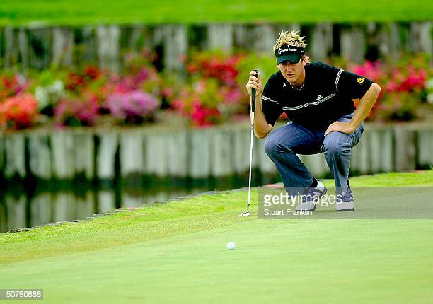 Ian Poulter of England lines up his putt on the 18th hole during the rain delayed second round at The Telecom Italian Open at Castello di Tolcinasco...