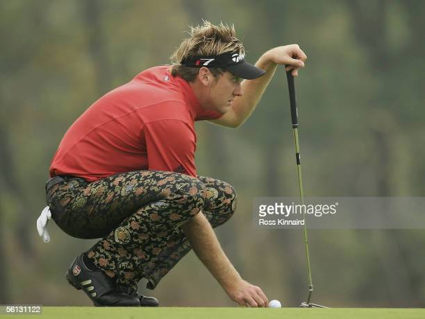 Ian Poulter of England lines up his putt on the par four 10th hole during the first round of the HSBC Champions Tournament at the Sheshan...