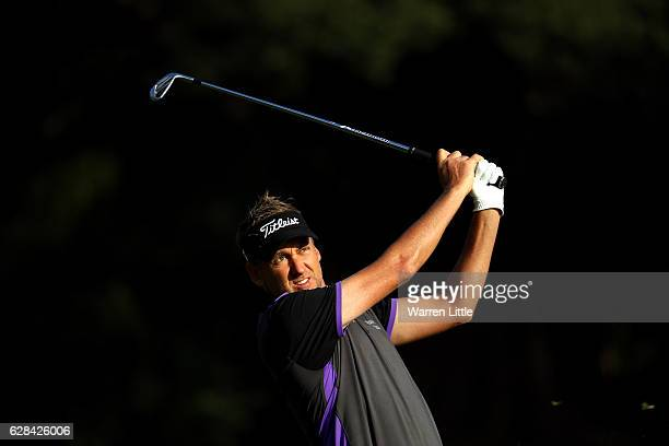 Ian Poulter of England play his second shot into the 15th green during the first round of the UBS Hong Kong Open at The Hong Kong Golf Club on...