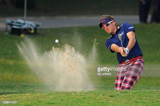 Ian Poulter of England plays a bunker shot during the Hong Kong Open golf tournament at the Hong Kong Golf Club on November 19 2010 The race to be...