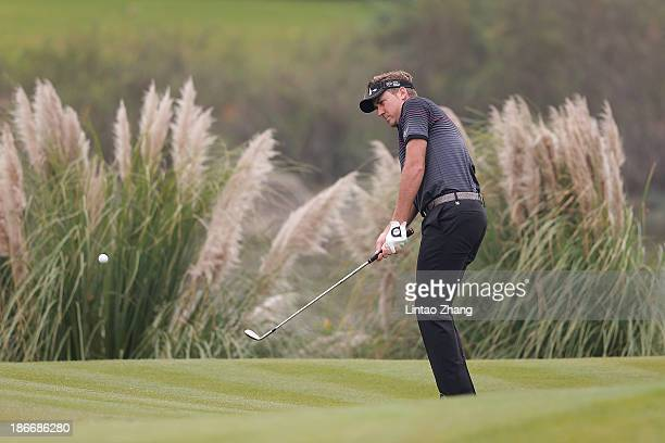 Ian Poulter of England plays a shot during the final round of the WGC - HSBC Champions at the Sheshan International Golf Club on November 3, 2013 in...