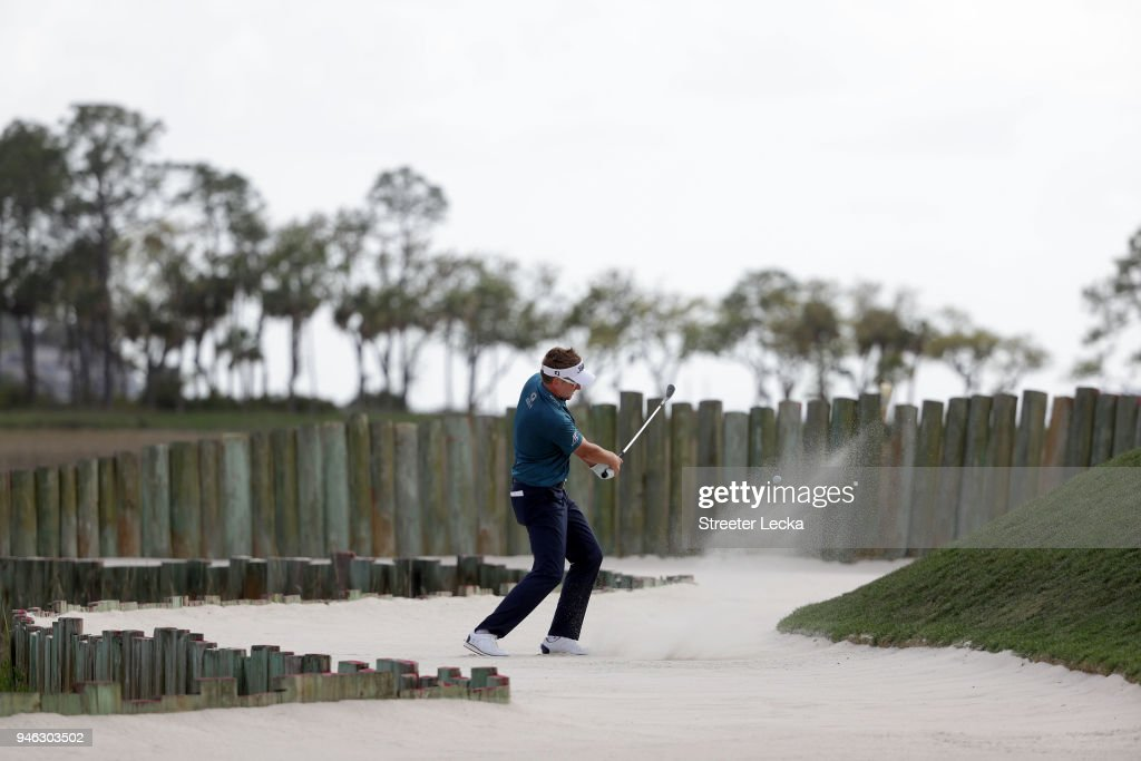 Ian Poulter of England plays a shot from a greenside bunker on the 17th hole during the third round of the 2018 RBC Heritage at Harbour Town Golf Links on April 14, 2018 in Hilton Head Island, South Carolina.
