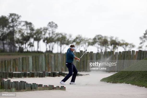 Ian Poulter of England plays a shot from a greenside bunker on the 17th hole during the third round of the 2018 RBC Heritage at Harbour Town Golf...
