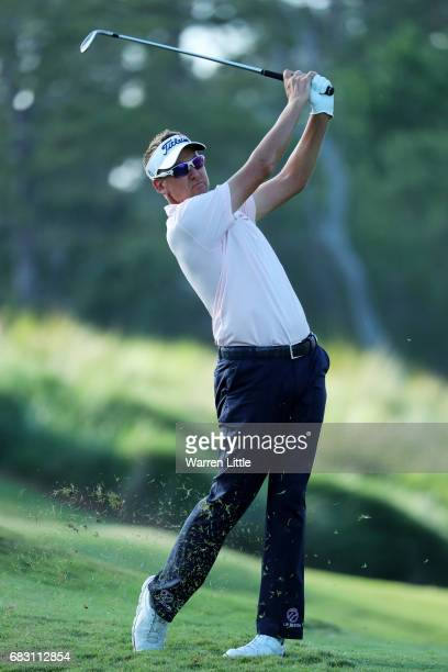 Ian Poulter of England plays a shot on the 16th hole during the final round of THE PLAYERS Championship at the Stadium course at TPC Sawgrass on May...