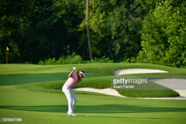 Ian Poulter of England plays a shot on the 17th hole during the continuation of the weather delayed second round of the 2018 PGA Championship at...