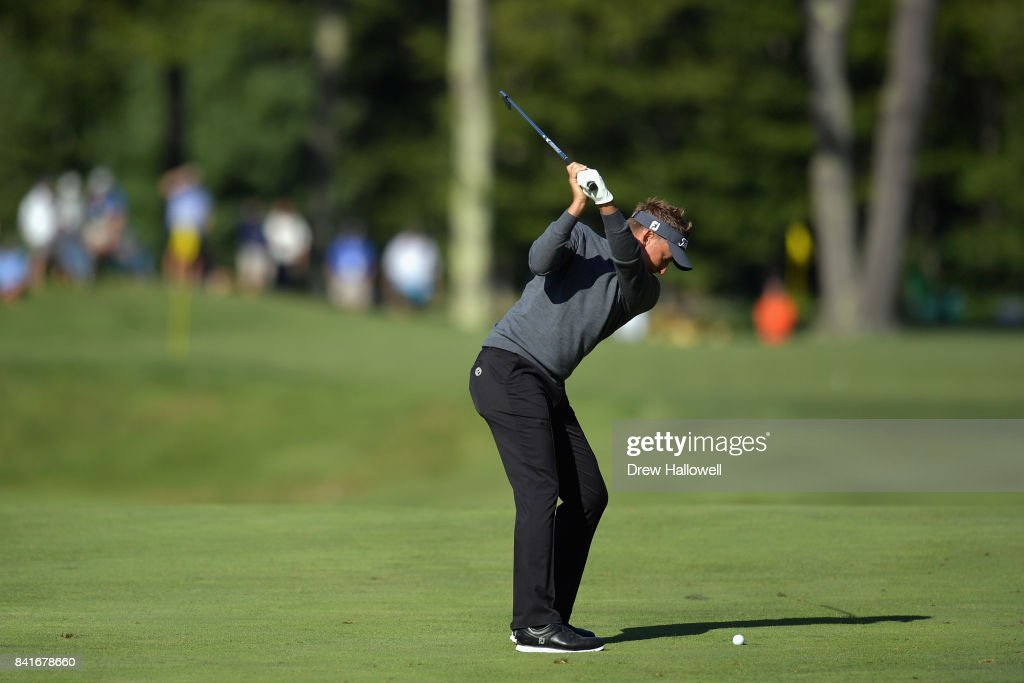 Ian Poulter of England plays a shot on the fifth hole during round one of the Dell Technologies Championship at TPC Boston on September 1, 2017 in Norton, Massachusetts.
