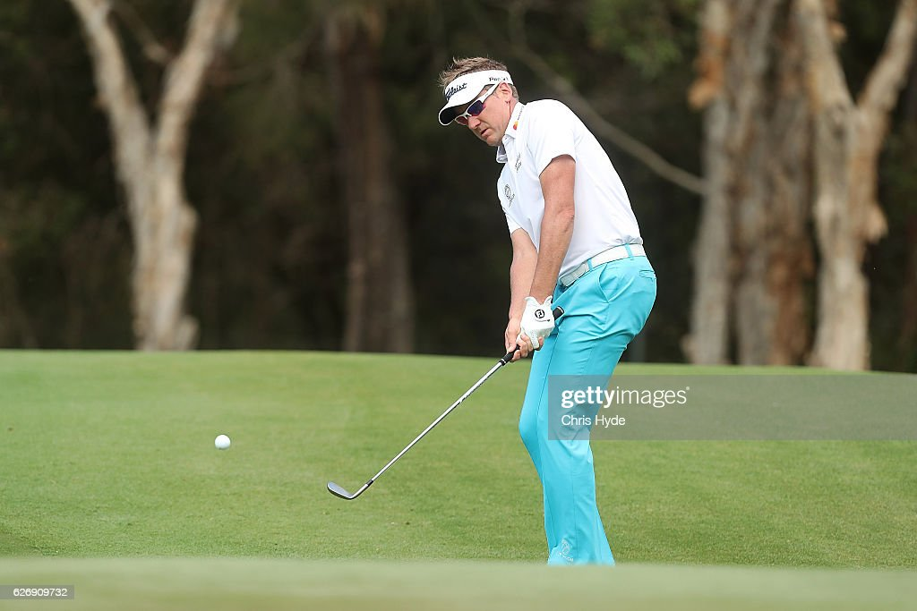 Ian Poulter of England plays an approach shot during day one of the 2016 Australian PGA Championship at RACV Royal Pines Resort on December 1, 2016 in Gold Coast, Australia.