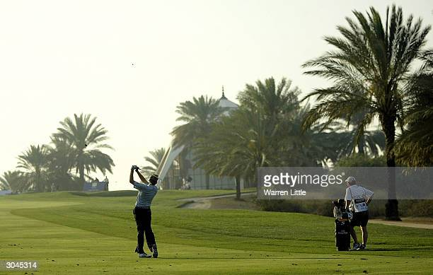 Ian Poulter of England plays his approch shot into the eighth green during the second round of the 2004 Dubai Desert Classic played on the Majilis...