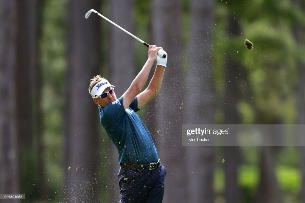 Ian Poulter of England plays his second shot from the 15th fairway during the third round of the 2018 RBC Heritage at Harbour Town Golf Links on April 14, 2018 in Hilton Head Island, South Carolina.